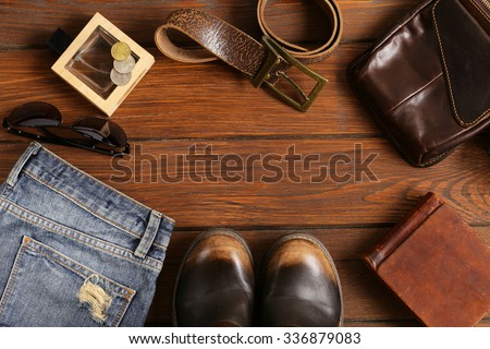 Fashionable men set on a wooden background - stock photo