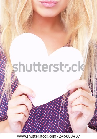 Fashionable photo of attractive woman holding in hands big white paper heart, face part, sexy lips, love concept - stock photo