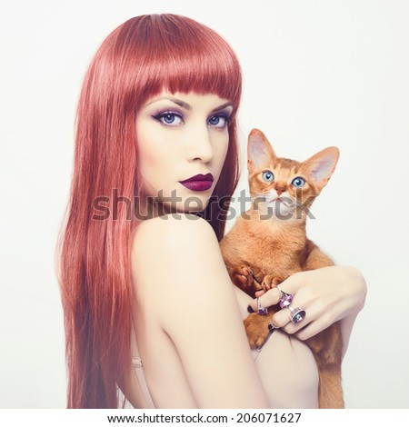 Fashionable photo of elegant lady with Abyssinian cat - stock photo