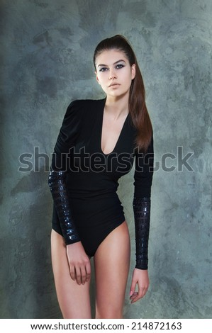 Fashionable portrait of a beautiful model in a black body. Strong look. Powerful concept. - stock photo