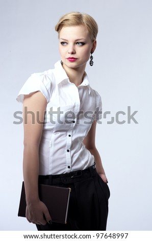 Fashionable portrait of beautiful young business woman - stock photo