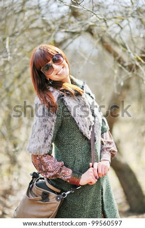Fashionable smiling woman with sunglasses outdoors - stock photo