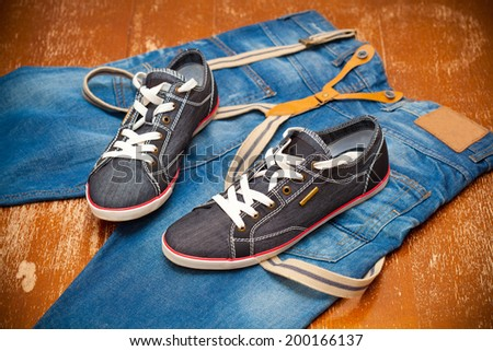 fashionable sneakers and jeans - stock photo