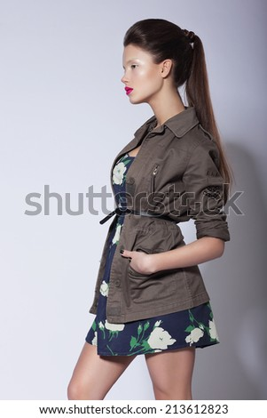 Fashionable Stylish Woman posing in Elegant Grey Coat  - stock photo