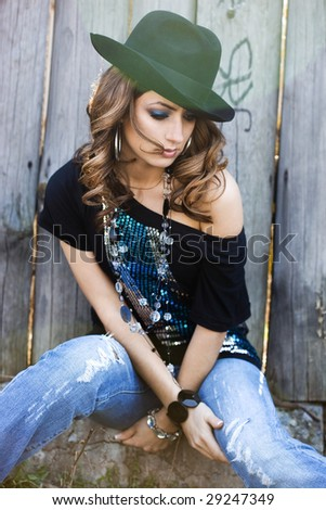 fashionable woman and ray of sun - stock photo