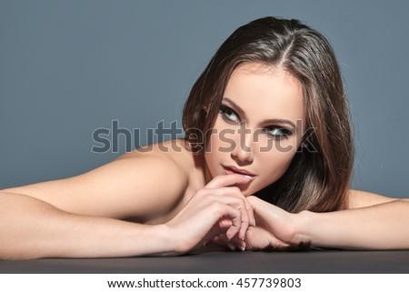 Fashionable woman. Beautiful female face. Woman of high society. Heartbreaker. Beauty woman. Portrait of amazing young fashion woman posing at studio. - stock photo