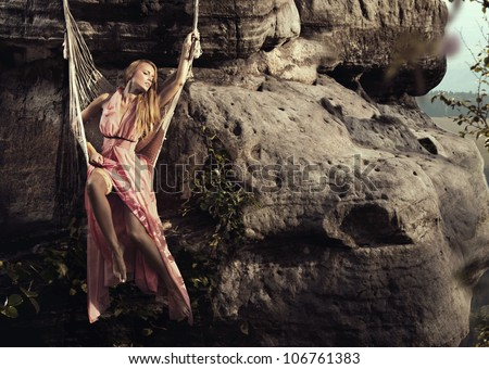 Fashionable woman in mountain - stock photo