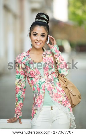 Fashionable woman talking cell phone bussiness woman smiling girl with smartphone, female on city street with mobile phone doing selfie, series - stock photo