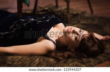 Fashionable women lying on the floor in a luxury boudoir - stock photo