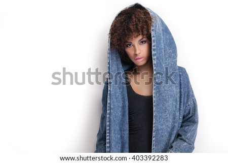 Fashionable young african american girl posing in studio. Woman with afro. - stock photo