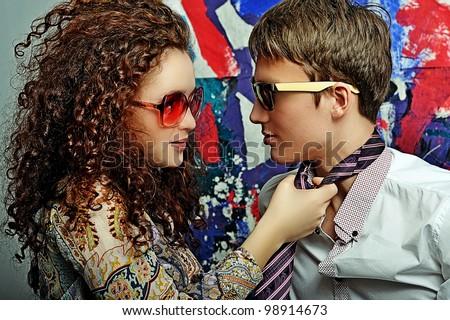 Fashionable young couple - stock photo