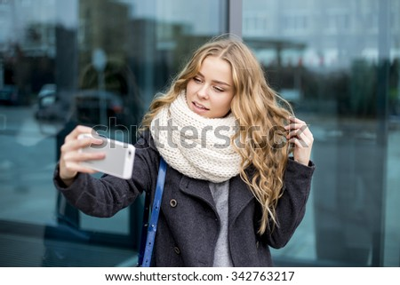 Fashionable young Woman in black coat and white scarf  - stock photo