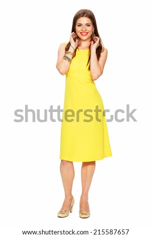 Fashionable young woman in yellow dress posing on white background. Isolated. - stock photo