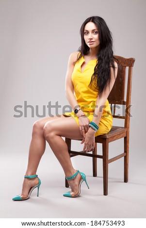 Fashionable young woman studio portrait - stock photo