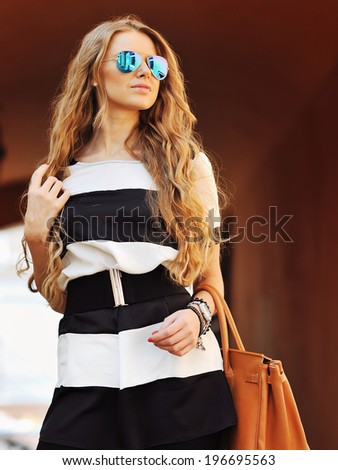 Fashionable young woman with a bag  - stock photo