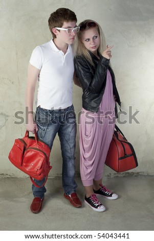 Fashioned couple on a vintage background - stock photo
