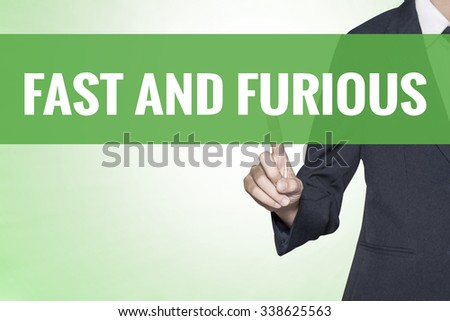 Fast and Furious word on green virtual screen touching by business woman - stock photo