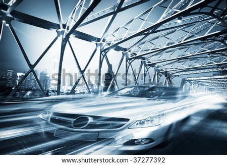 Fast car moving in motion on the  Garden Bridge of shanghai china. - stock photo