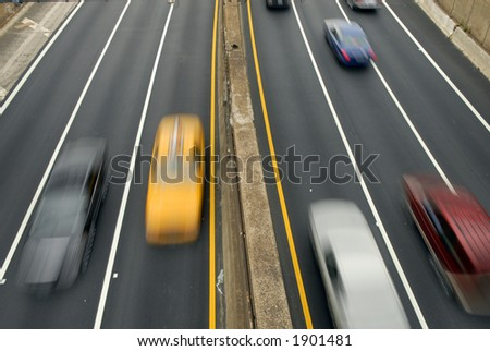 fast cars on the highway - stock photo