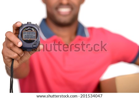 Fast delivery. Timer for foreground. African american delivery man carrying parcel and presenting receiving form - stock photo