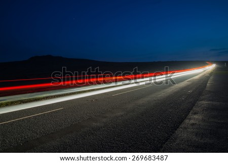 fast driving car trials at night,long exposure blurred effect - stock photo