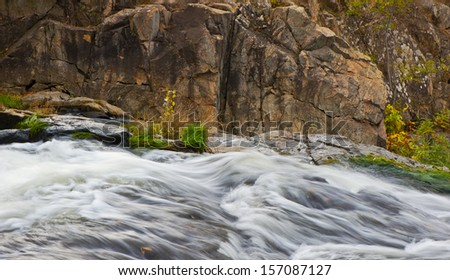 fast-flowing water of the river and granite rocks, fall - stock photo