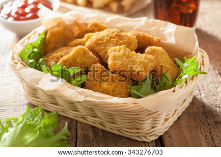 fast food chicken nuggets with ketchup french fries cola - stock photo