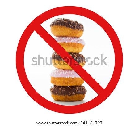 fast food, low carb diet, fattening and unhealthy eating concept - close up of glazed donuts pile over white behind no symbol or circle-backslash prohibition sign - stock photo