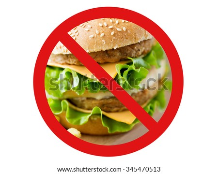 fast food, low carb diet, fattening and unhealthy eating concept - close up of hamburger or cheeseburger behind no symbol or circle-backslash prohibition sign - stock photo