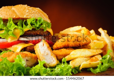 Fast food menu with chicken nuggets, hamburger and french fries - stock photo