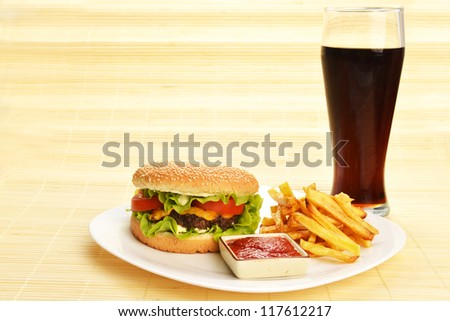 Fast food tasty hamburger with french fries and cola - stock photo