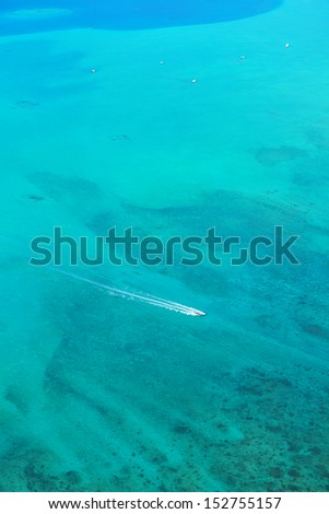 fast motor speed boat travel with splash and wake on blue tropical sea backround - stock photo