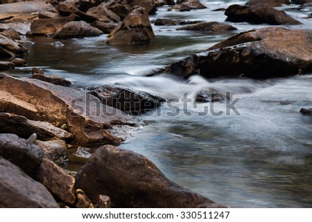 fast mountain river flowing among stones. landscape - stock photo