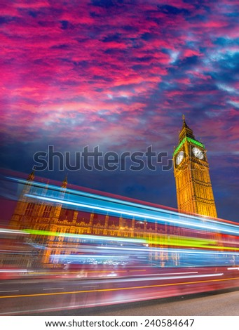 Fast moving Double Decker bus in front of Big Ben, London. - stock photo