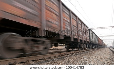 Fast moving freight coal trainload. Coal trainload in motion - stock photo