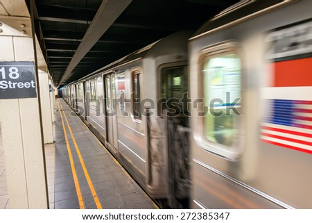 Fast moving train in New York subway. 18th street station. - stock photo