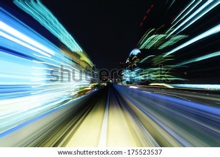 Fast moving train trail - stock photo