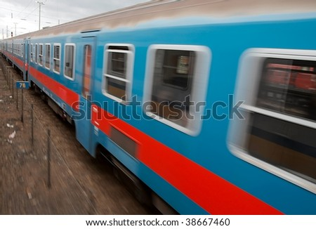 Fast passenger train with motion blur - stock photo