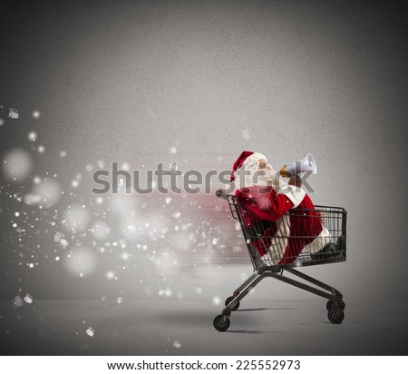 Fast Santa Claus announcement in a shopping cart - stock photo