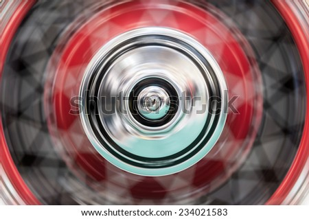 Fast spinning wheel of a car. Motion blur and fast speed. - stock photo