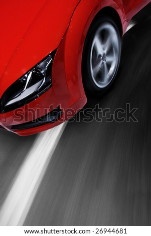 Fast sports car moving with motion blur and zooming effect - stock photo