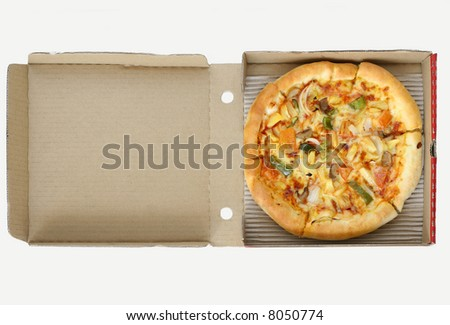 Fast take away vegetarian pizza on its cardboard box ready to be eaten - stock photo