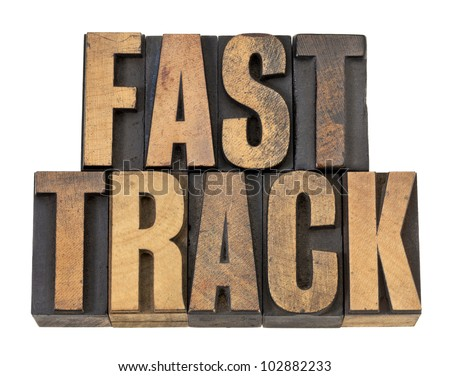 fast track - career concept - isolated text in vintage letterpress wood type - stock photo