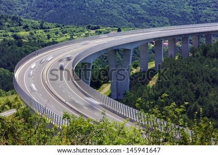 Fast traffic on the bridge of a slovenian highway - stock photo