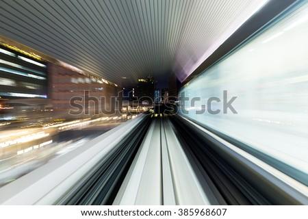 Fast train through city - stock photo