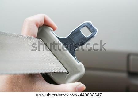 Fasten the car seat belt - stock photo
