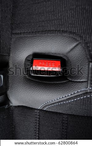 fasten your seat belt concept with red button and black copyspace - stock photo