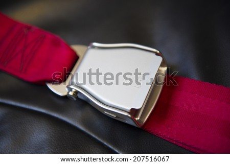Fastened airplane seat belt on a passenger seat - stock photo