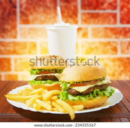 fastfood burgers, soda and fries - stock photo