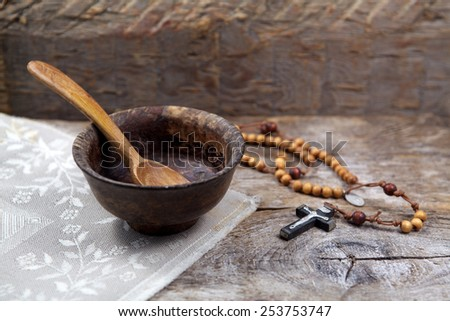 Fasting, Lent. Cup and cross. - stock photo